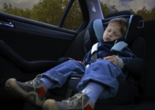child fallen asleep in car seat