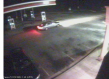security camera still shot of car